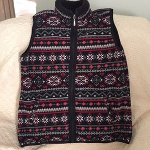 Fleece patterned vest great for the holiday.